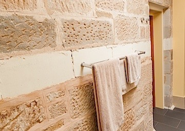 Bathroom and exterior stone cladding at Parkside S.A.